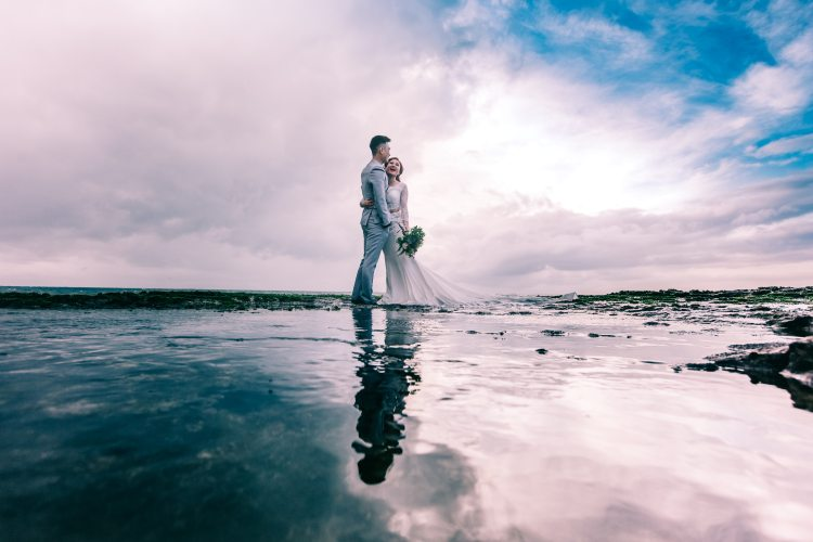 Couple on beach with clouds for tim downer independent celebrant